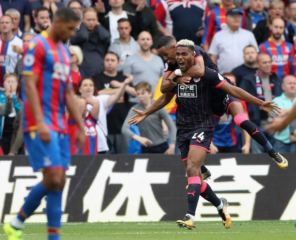 LONDON, ENGLAND - AUGUST 12: Steve Mounie of Huddersfield Town celebrates scoring his sides second goal during the Premier League match between Crystal Palace and Huddersfield Town at Selhurst Park on August 12, 2017 in London, England. (Photo by Christopher Lee/Getty Images)