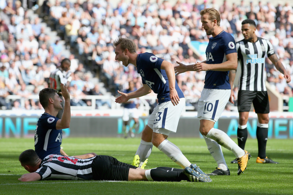 NEWCASTLE UPON TYNE, ENGLAND - AUGUST 13: Ben Davies of Tottenham Hotspur celebrates scoring his sides second goal with Christian Eriksen of Tottenham Hotspur and Harry Kane of Tottenham Hotspur during the Premier League match between Newcastle United and Tottenham Hotspur at St. James Park on August 13, 2017 in Newcastle upon Tyne, England. (Photo by Alex Livesey/Getty Images)