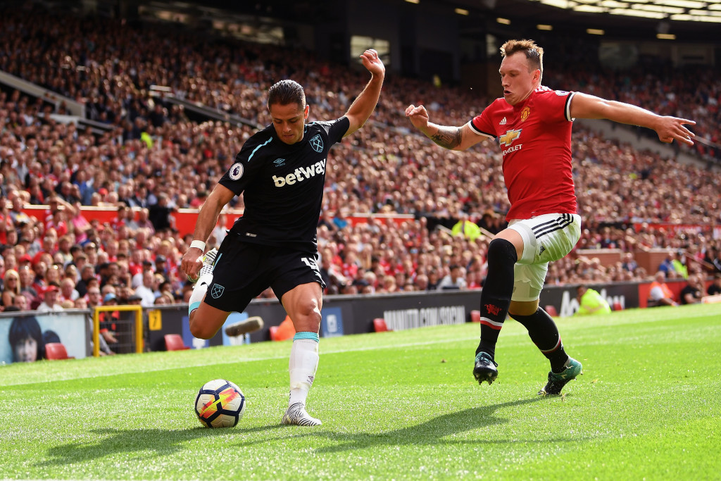 MANCHESTER, ENGLAND - AUGUST 13: Javier Hernandez of West Ham United attempts to cross as Phil Jones of Manchester United attempts to block during the Premier League match between Manchester United and West Ham United at Old Trafford on August 13, 2017 in Manchester, England. (Photo by Michael Regan/Getty Images)