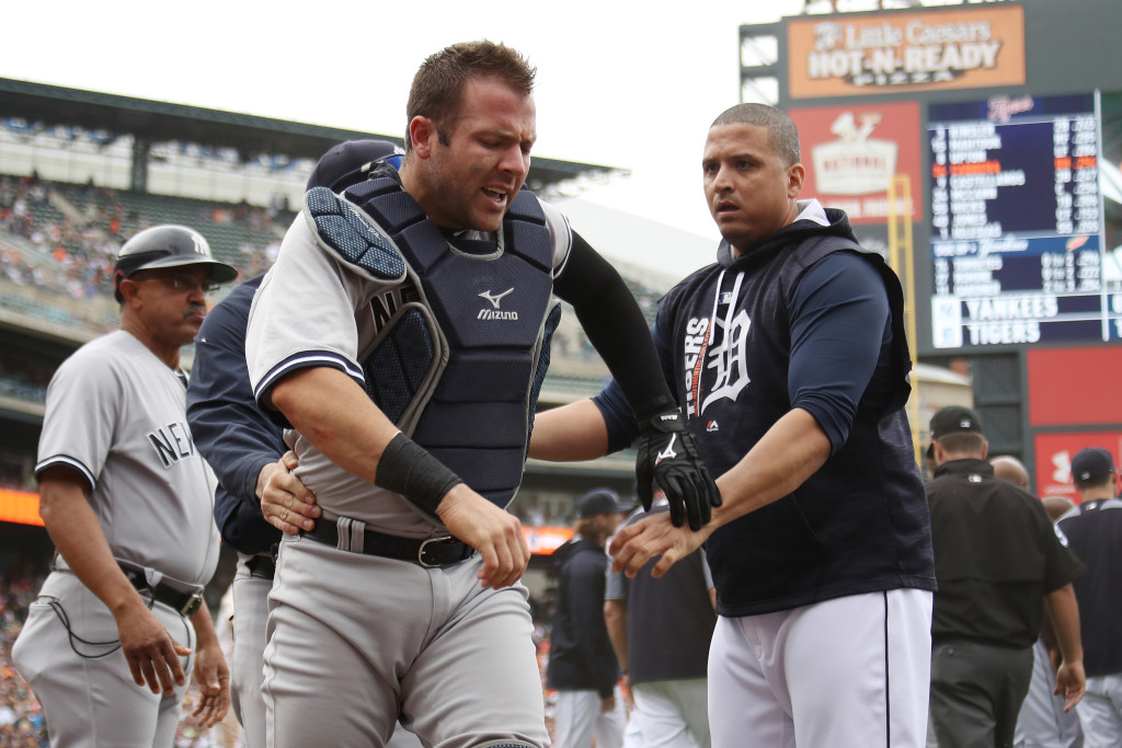 DETROIT, MI - AUGUST 24: Austin Romine #27 of the New York Yankees is held back by Victor Martinez #41 of the Detroit Tigers during a bench clearing fight in the sixth inning at Comerica Park on August 24, 2017 in Detroit, Michigan. (Photo by Gregory Shamus/Getty Images)