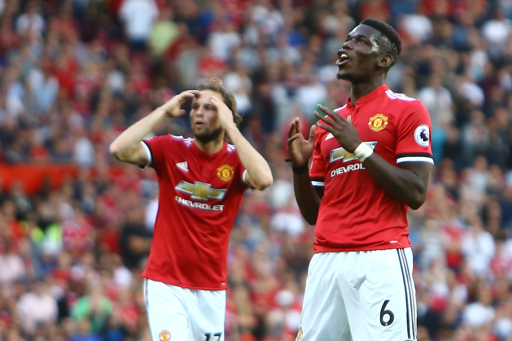 Pogba reacts after hitting a shot wide
