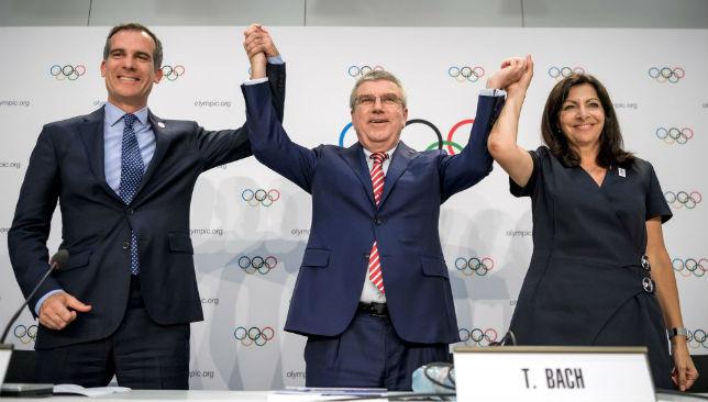 LA Mayor Eric Garcetti, IOC's President German Thomas Bach and Mayor of Paris Anne Hidalgo