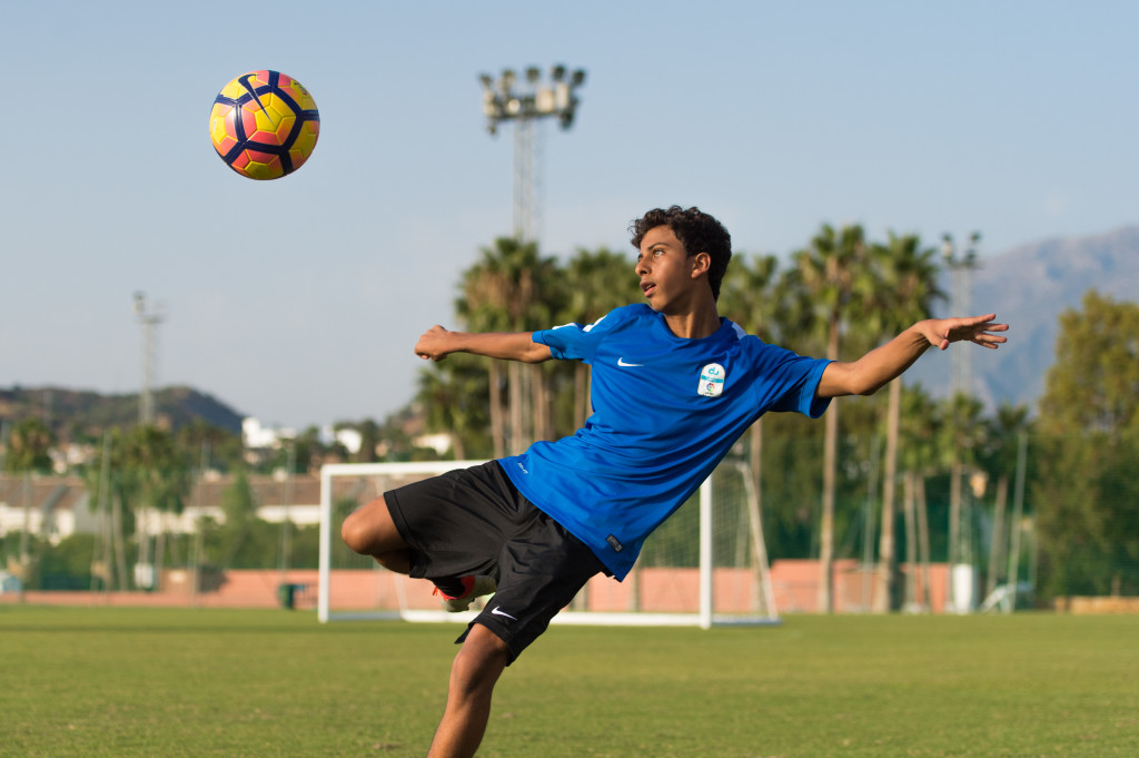 Serve and volley: Under-16s player Omar Taha.