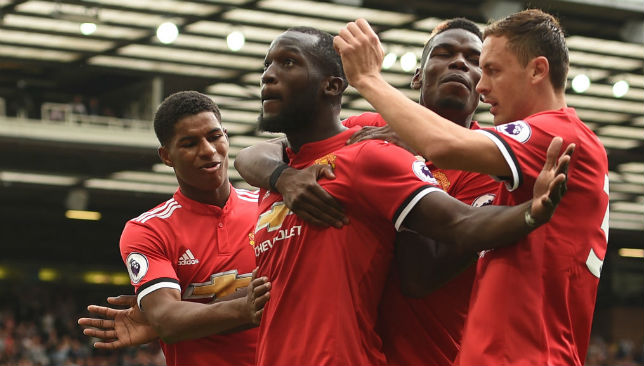 Romelu Lukaku celebrates scoring a goal with his team-mates.