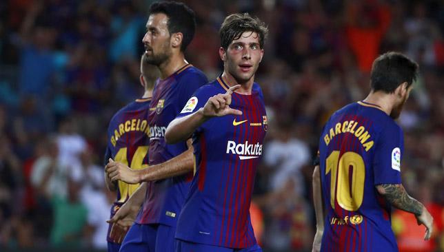 Sergi Roberto (c) celebrates scoring Barcelona's second goal.