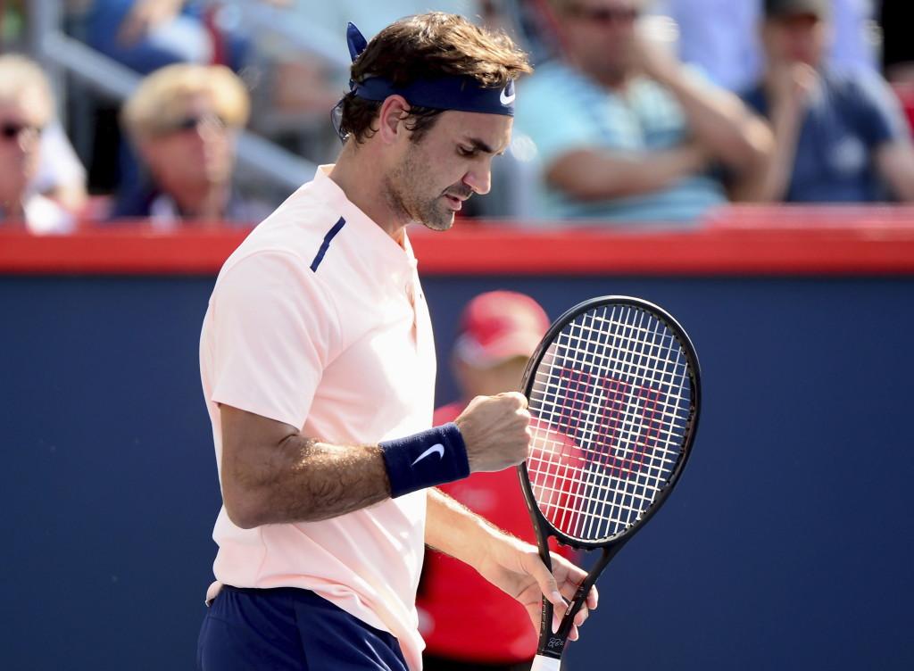Roger Federer reacts after winning the first set