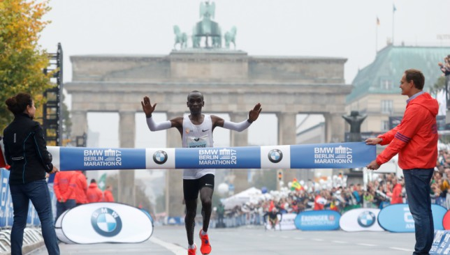 Kipchoge makes his way over finish line in rain-soaked Berlin.