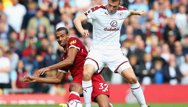 Liverpool's Joel Matip puts in a tackle against Burnley's Chris Wood.