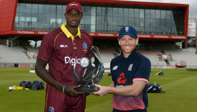 Eoin Morgan (r) and Jason Holder.