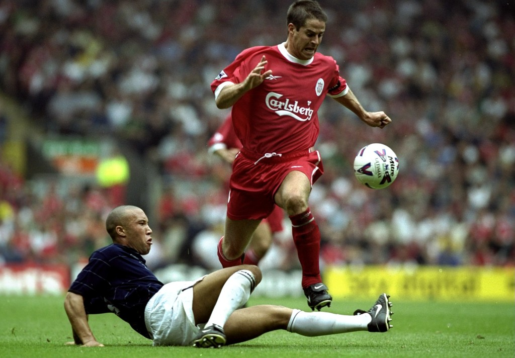 11 Sep 1999: Jamie Redknapp of Liverpool gets past Mickael Silvestre of Manchester United during the FA Carling Premiership match at Anfield in Liverpool, England. United won 3-2. Mandatory Credit: Ben Radford /Allsport