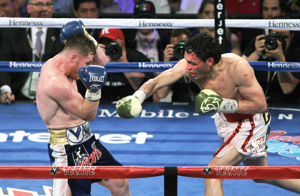 Canelo slips a shot from Julio Cesar Chavez, Jr. in his last fight