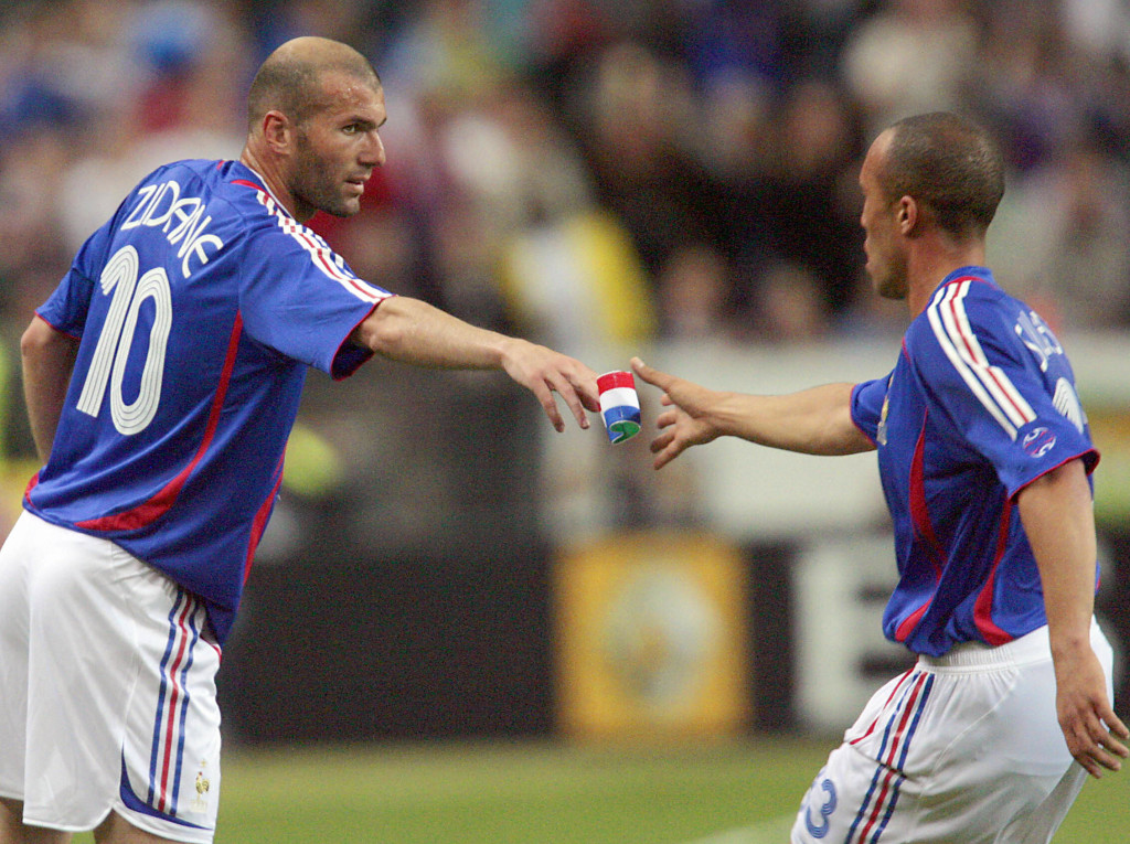 Saint-Denis, FRANCE: France's midfielder Zinedine Zidane (L) gives his captain armband to defender Mickael Silvestre as he leaves the pitch for a substitution during the friendly test match France vs. Mexico, ahead of the 2006 World Cup, 27 May 2006 at the Stade de France in Saint-Denis, north of Paris. AFP PHOTO/ PASCAL PAVANI (Photo credit should read PASCAL PAVANI/AFP/Getty Images)