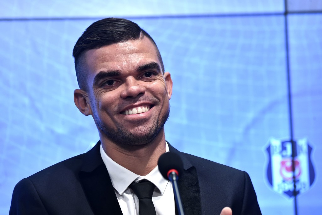 Besiktas' new Portuguese defender Pepe smiles during his signing ceremony with the club on July 5, 2017, at the Vodafone Park stadium in Istanbul. Portuguese international defender Pepe on July 5 arrived in Istanbul to join Turkish champions Besiktas from Real Madrid on a two-year deal. According to the NTV Spor website, Pepe will receive an annual salary of 3.35 million euros ($3.8 million), plus performance bonuses, as well as a sign-on fee of three million euros. / AFP PHOTO / OZAN KOSE (Photo credit should read OZAN KOSE/AFP/Getty Images)