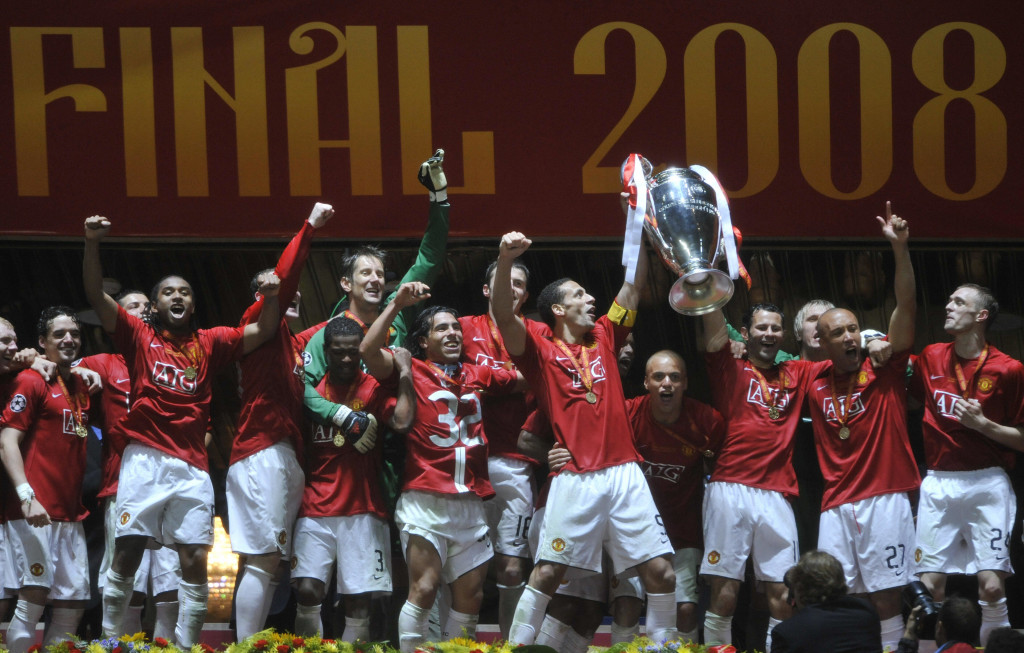 Manchester United players pose with the trophy after beating Chelsea in the final of the Champions League football match at the Luzhniki stadium in Moscow on May 21, 2008. The match remained at a 1-1 draw and Manchester won on penalties after extra time. AFP PHOTO / Franck Fife (Photo credit should read FRANCK FIFE/AFP/Getty Images)