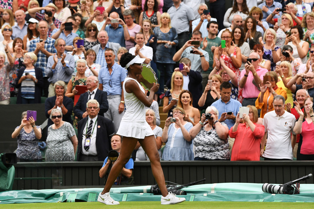 LONDON, ENGLAND - JULY 15: Runner-up Venus Williams of The United States walks with her trophy after the Ladies Singles final against Garbine Muguruza of Spain on day twelve of the Wimbledon Lawn Tennis Championships at the All England Lawn Tennis and Croquet Club at Wimbledon on July 15, 2017 in London, England. (Photo by David Ramos/Getty Images)