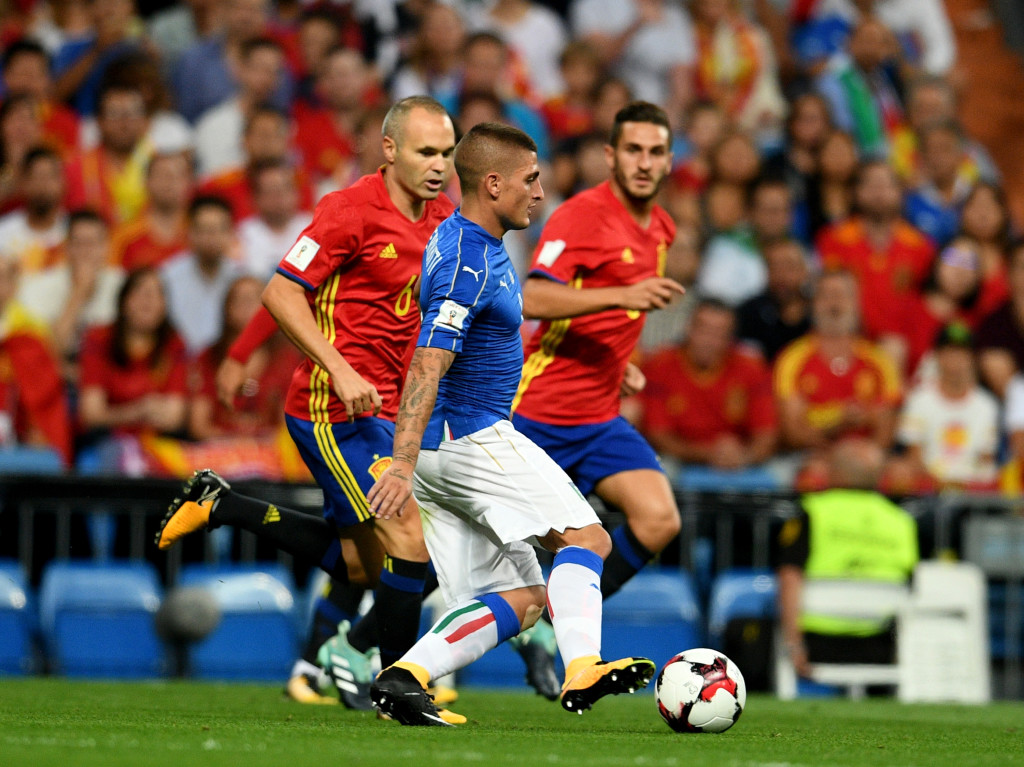 Verratti is chased down Iniesta