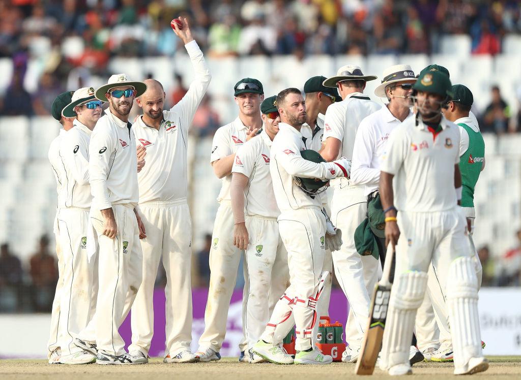 Lyon celebrates his five-wicket haul after dismissing Shabbir Rehman.