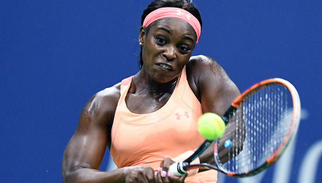 Sloane Stephens returns the ball to Venus Williams during their US Open semi-finals match.
