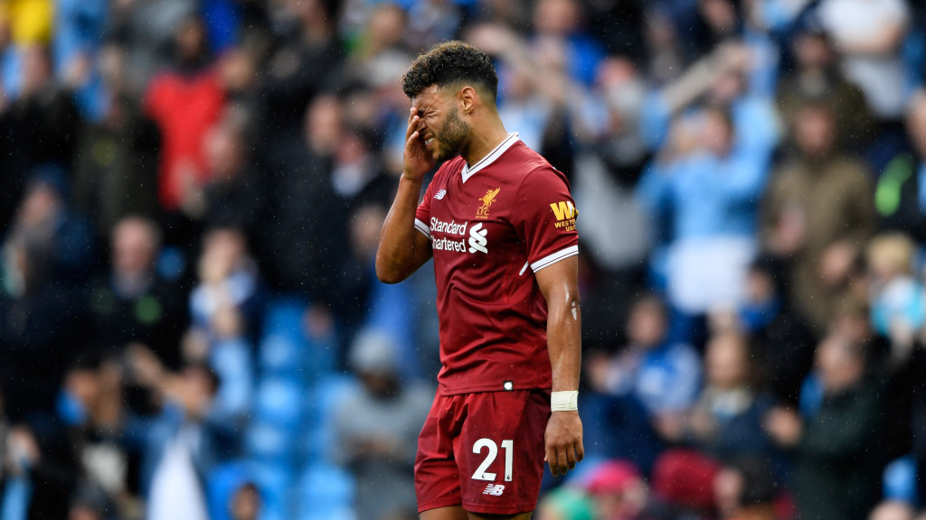 Alex Oxlade-Chamberlain grimaces after defeat to City