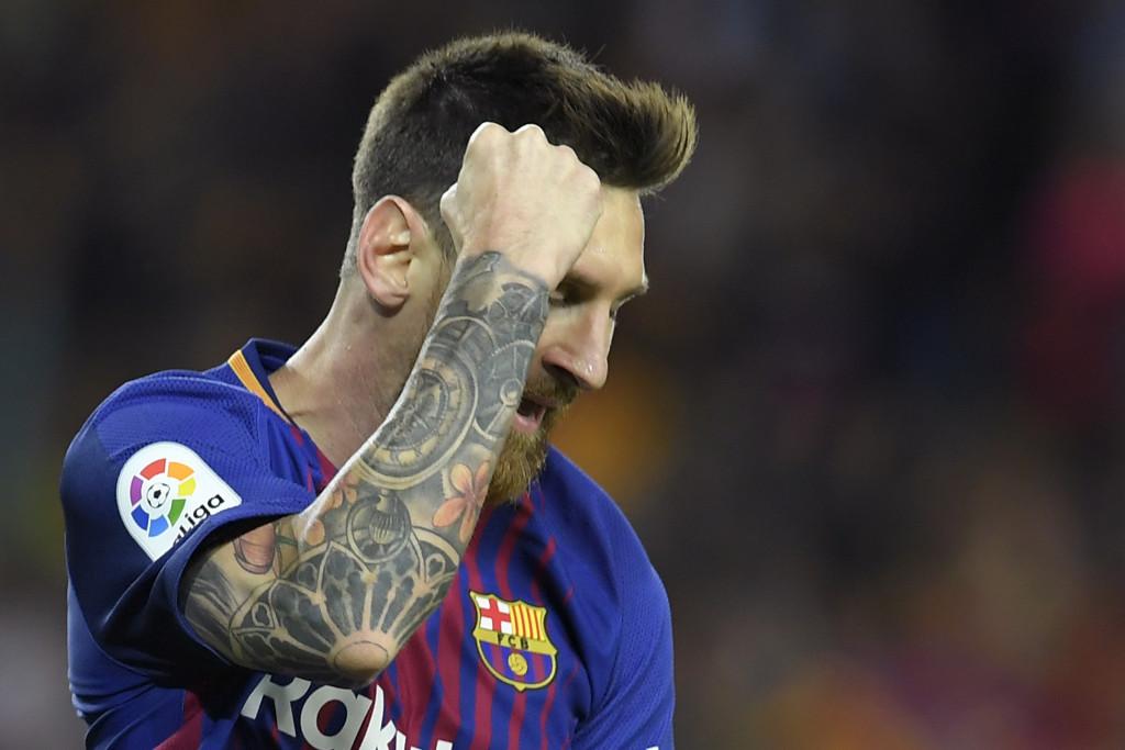 Lionel Messi celebrates his first goal