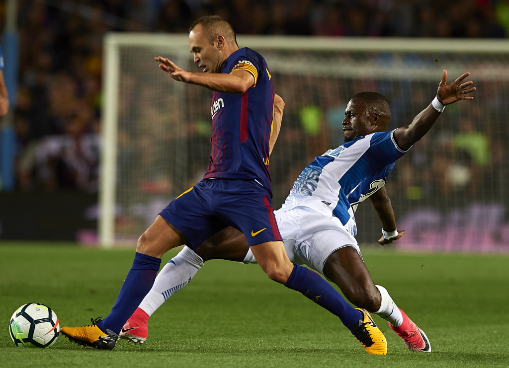 BARCELONA, SPAIN - SEPTEMBER 09: Andres Iniesta (L) of Barcelona is tackled by Papakouli Diop of Espanyol during the La Liga match between Barcelona and Espanyol at Camp Nou on September 9, 2017 in Barcelona, Spain. (Photo by Manuel Queimadelos Alonso/Getty Images)