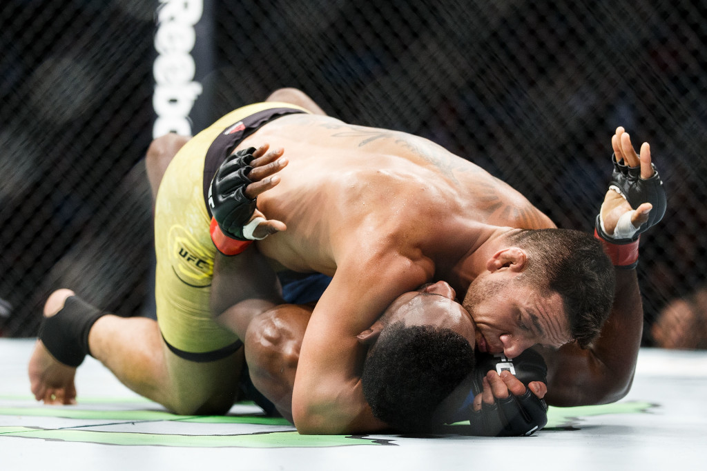 Rafael Dos Anjos works to submit Neil Magny