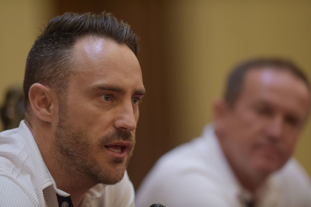 Faf du Plessis and Andy Flower speak to the media in Lahore on Monday.