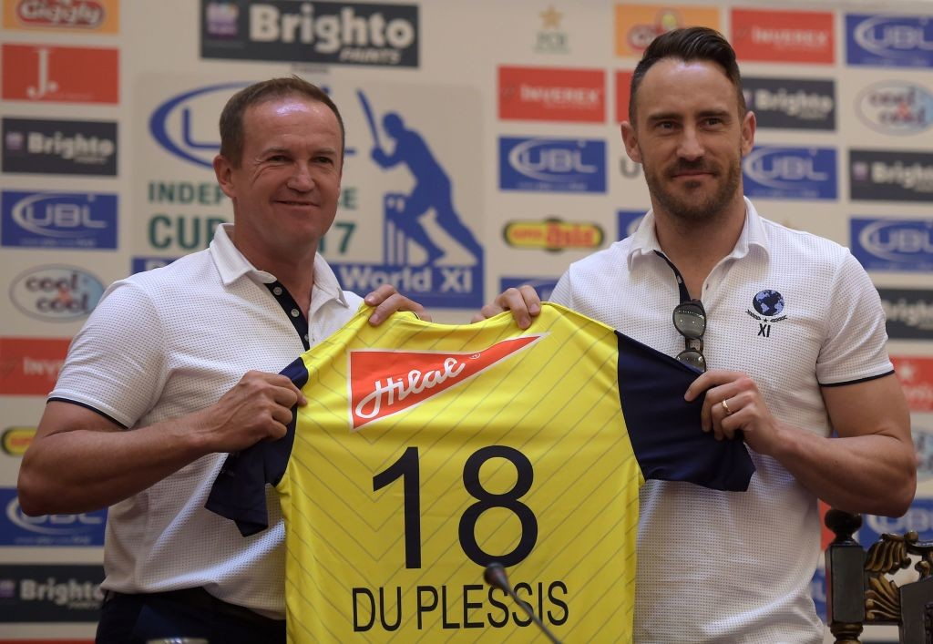 Faf du Plessis and Andy Flower unveil the World XI playing jersey.