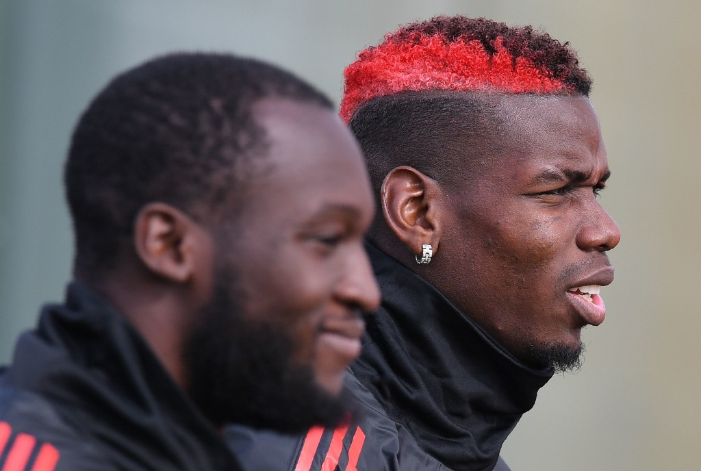 Manchester United's Belgian striker Romelu Lukaku (L) and Manchester United's French midfielder Paul Pogba attends a team training session at the club's training complex near Carrington, west of Manchester in north west England on September 11, 2017, on the eve of their UEFA Champions League Group A football match against FC Basel. / AFP PHOTO / Paul ELLIS (Photo credit should read PAUL ELLIS/AFP/Getty Images)