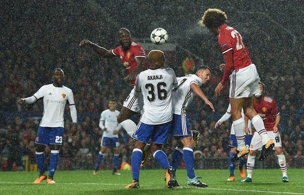 Marouane Fellaini heads the opening goal against Basel