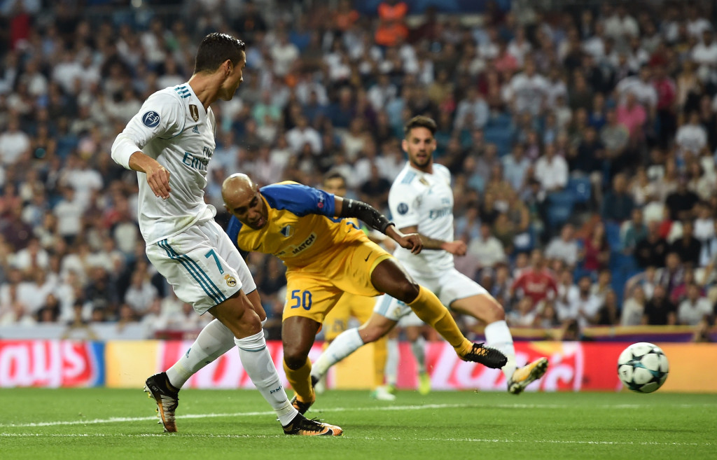 MADRID, SPAIN - SEPTEMBER 13: Cristiano Ronaldo of Real Madrid scores his sides first goal during the UEFA Champions League group H match between Real Madrid and APOEL Nikosia at Estadio Santiago Bernabeu on September 13, 2017 in Madrid, Spain. (Photo by Denis Doyle/Getty Images)