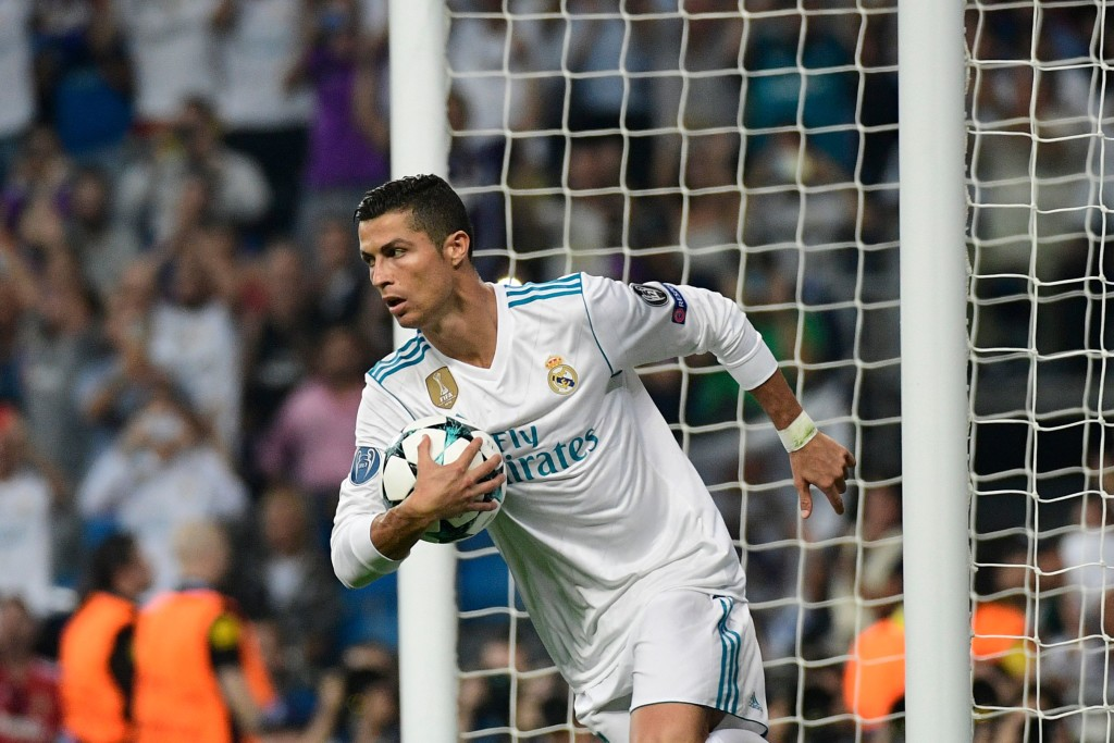 Real Madrid's forward from Portugal Cristiano Ronaldo celebrates after scoring on a penalty kick during the UEFA Champions League football match Real Madrid CF vs APOEL FC at the Santiago Bernabeu stadium in Madrid on September 13, 2017. / AFP PHOTO / PIERRE-PHILIPPE MARCOU (Photo credit should read PIERRE-PHILIPPE MARCOU/AFP/Getty Images)