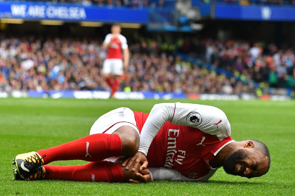 Lacazette lies injured after a collision with Victor Moses