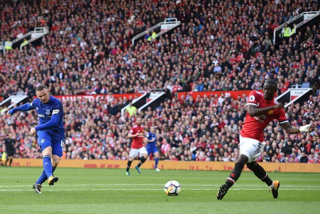 Wayne Rooney drags a shot wide
