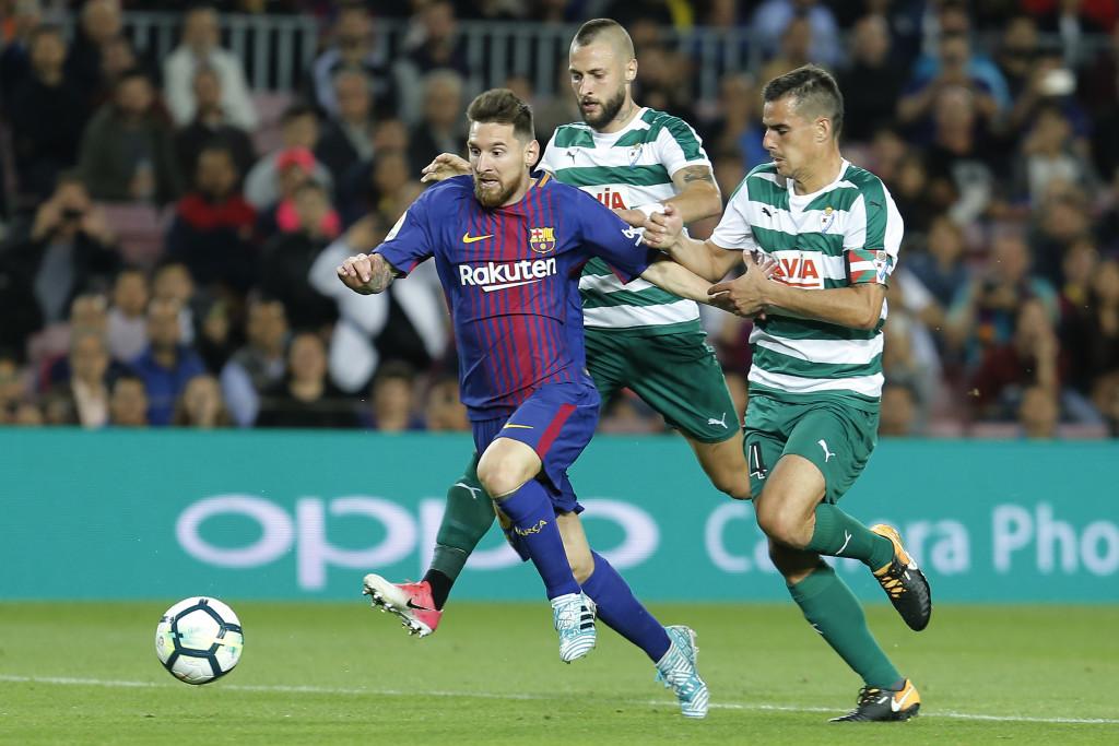 Messi runs alongside David Junca