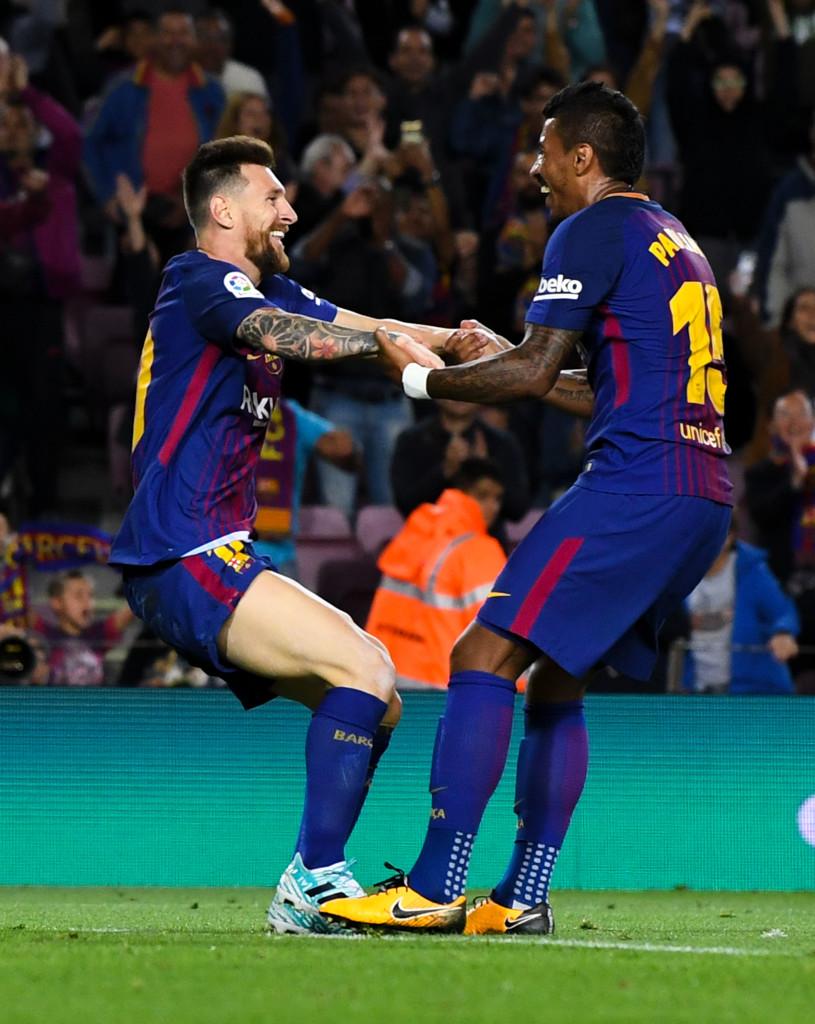 Messi and Paulinho celebrate