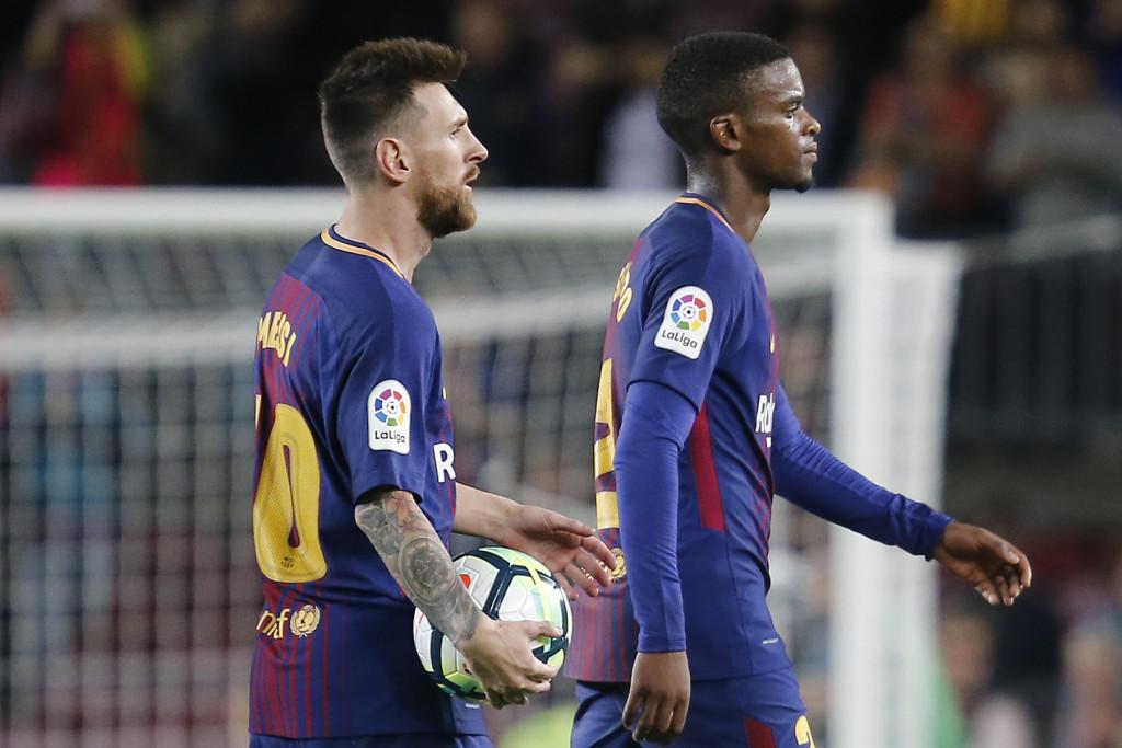 Lionel Messi with defender Nelson Semedo