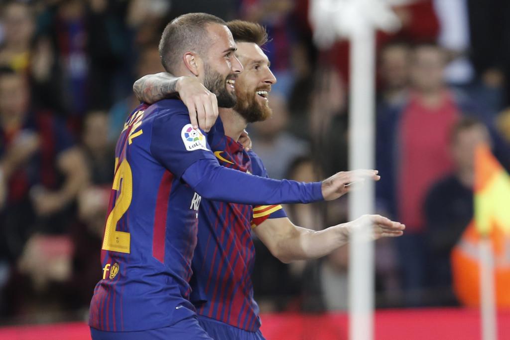 Messi celebrates with Vidal