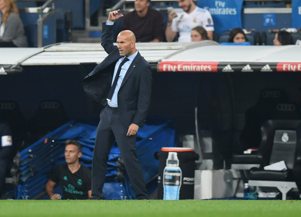 Real Madrid's coach from France Zinedine Zidane gestures during the Spanish league football match Real Madrid CF against Real Betis at the Santiago Bernabeu stadium in Madrid on September 20, 2017. / AFP PHOTO / GABRIEL BOUYS (Photo credit should read GABRIEL BOUYS/AFP/Getty Images)