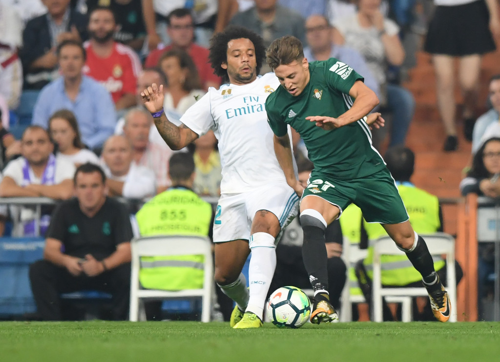 Real Madrid's defender from Brazil Marcelo (L) vies with Real Betis' forward from Spain Francis Guerrero during the Spanish league football match Real Madrid CF against Real Betis at the Santiago Bernabeu stadium in Madrid on September 20, 2017. / AFP PHOTO / GABRIEL BOUYS (Photo credit should read GABRIEL BOUYS/AFP/Getty Images)