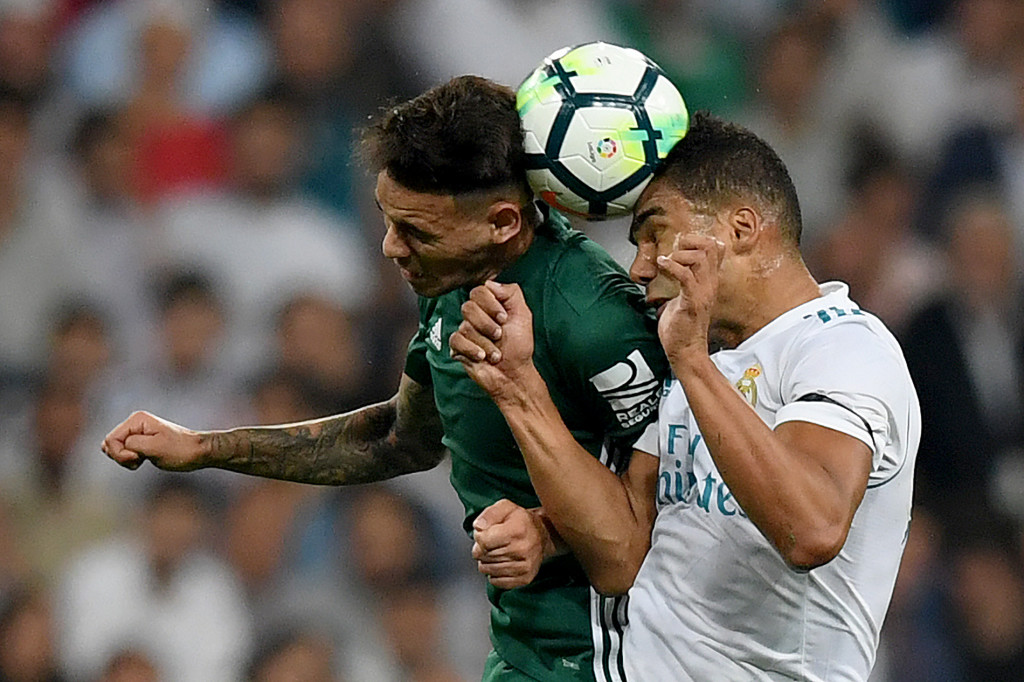Real Betis' forward from Paraguay Arnaldo Sanabria (L) vies with Real Madrid's midfielder from Brazil Casemiro during the Spanish league football match Real Madrid CF against Real Betis at the Santiago Bernabeu stadium in Madrid on September 20, 2017. / AFP PHOTO / GABRIEL BOUYS (Photo credit should read GABRIEL BOUYS/AFP/Getty Images)