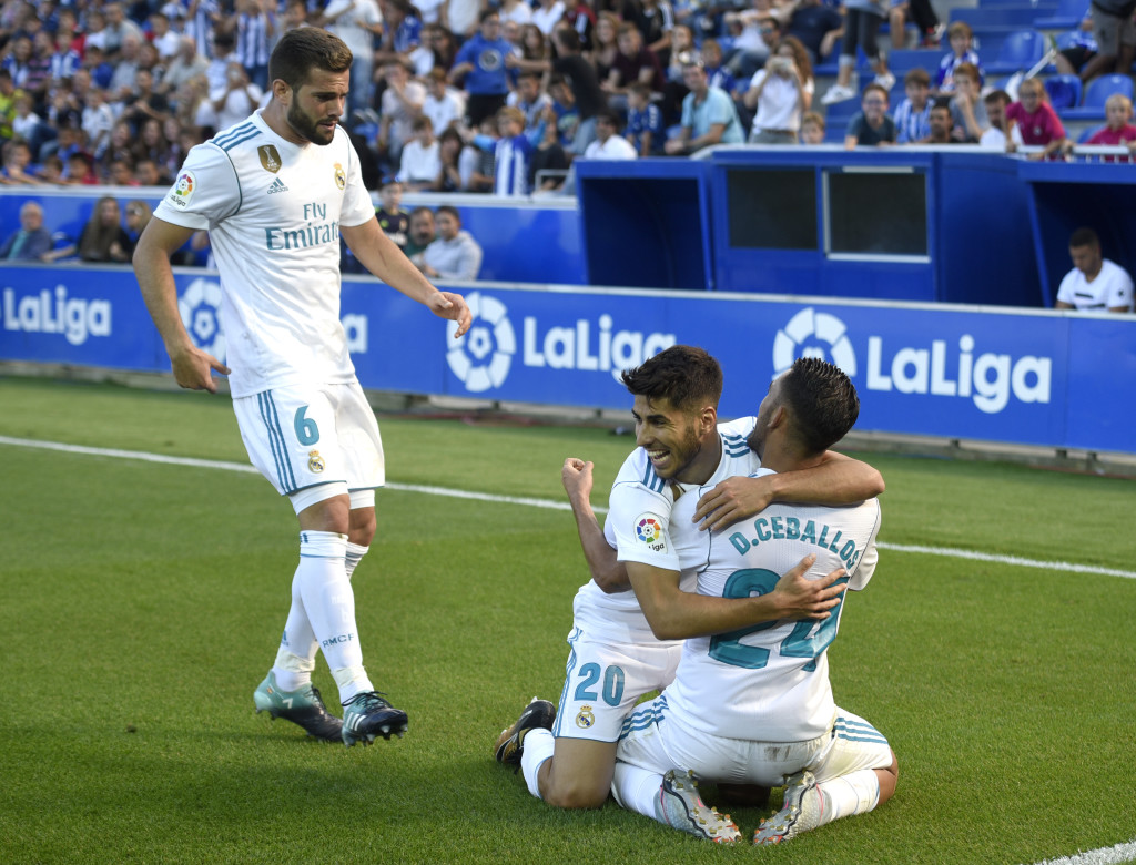 Nacho (L) celebrates with Dani Ceballos and Marco Asensio