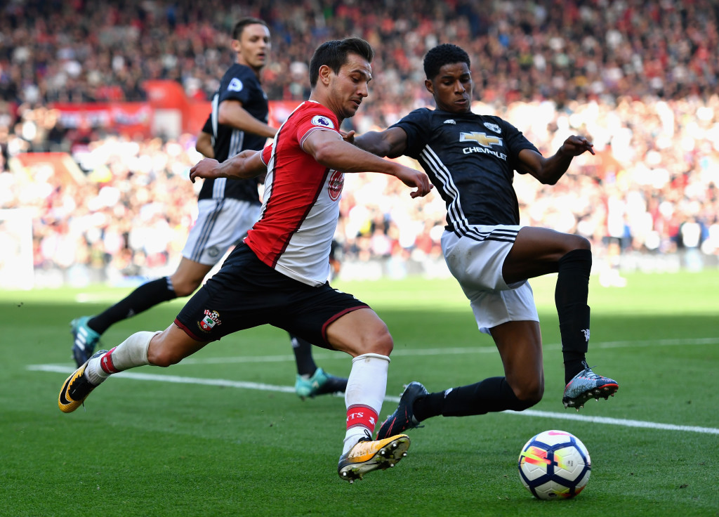 Marcus Rashford and Southampton's Cedric Soares compete for the ball