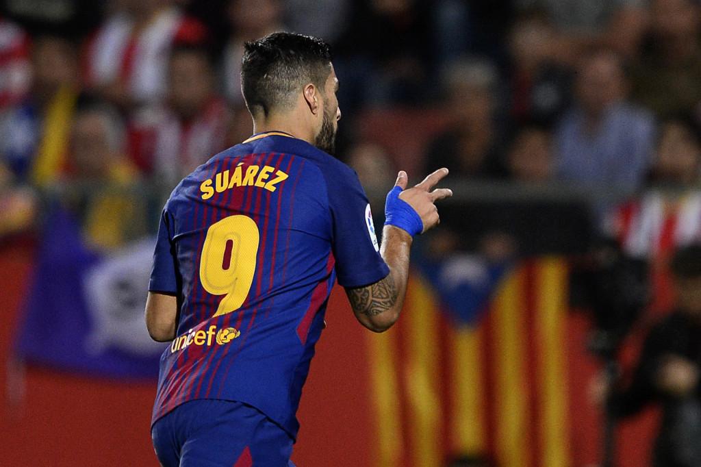 Luis Suarez celebrates his goal against Girona