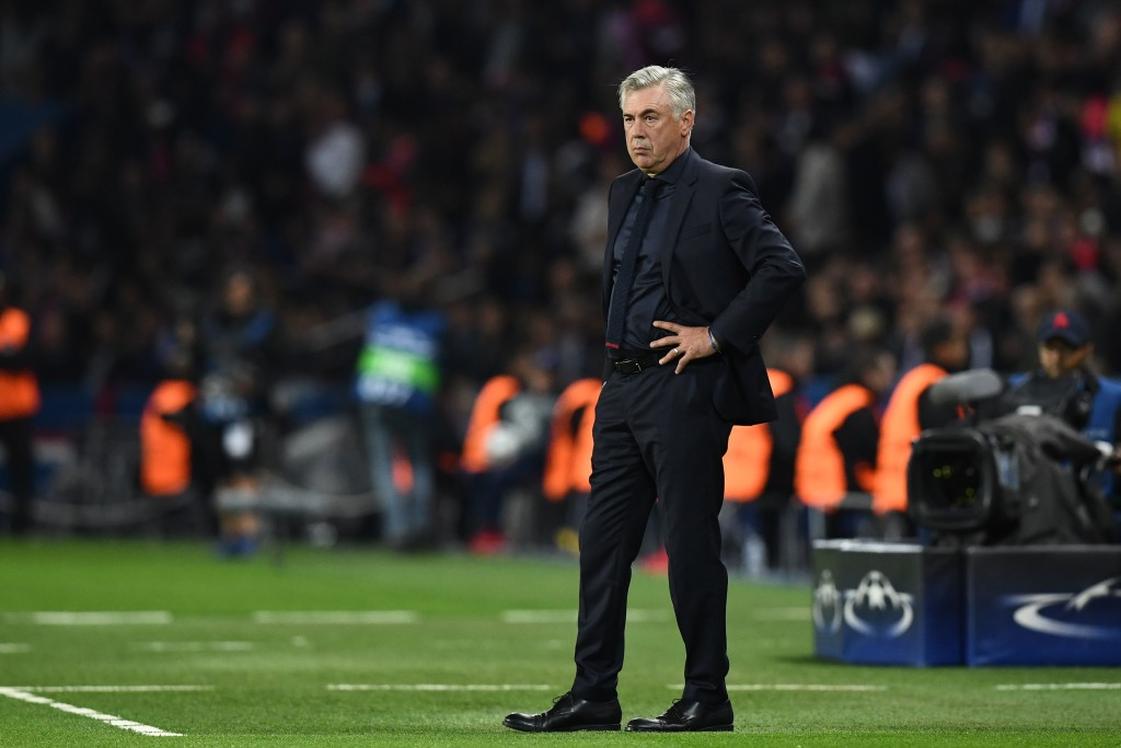 A grim looking Carlo Ancelotti looks on