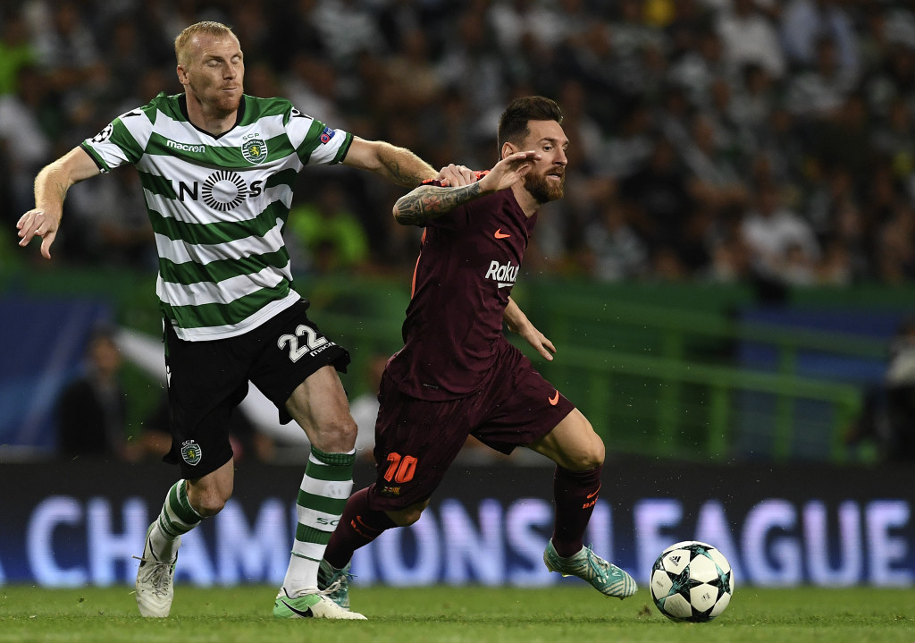 Jeremy Mathieu competes for the ball with Messi