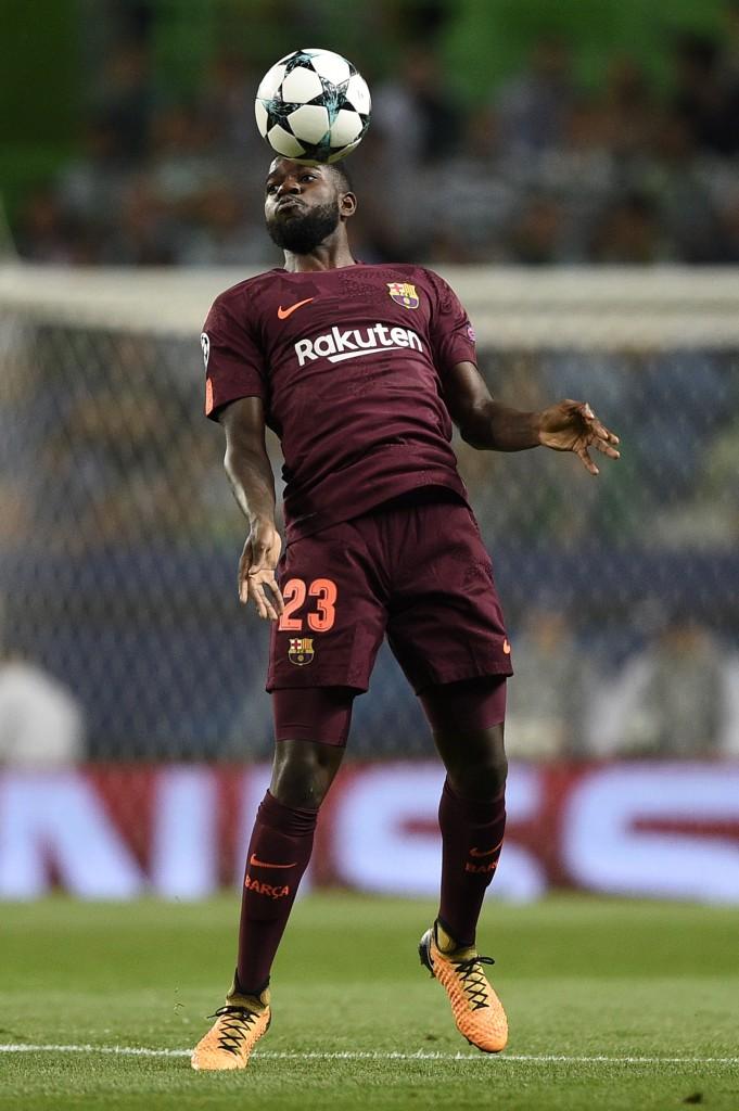 Samuel Umtiti heads clear against Sporting