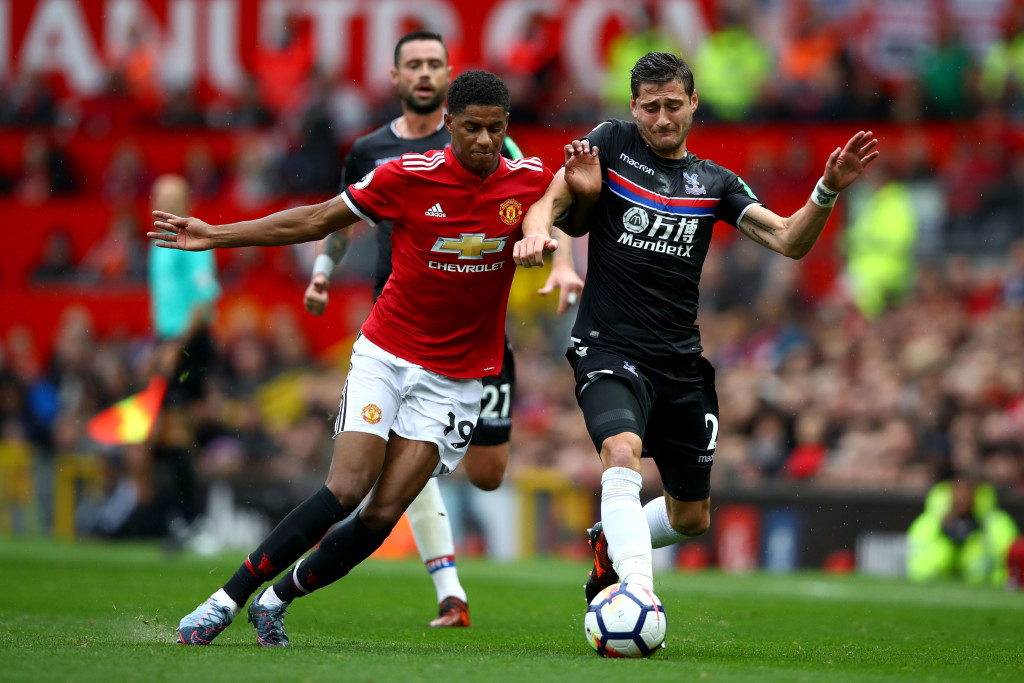 MANCHESTER, ENGLAND - SEPTEMBER 30: Marcus Rashford of Manchester United and Joel Ward of Crystal Palace compete for the ball during the Premier League match between Manchester United and Crystal Palace at Old Trafford on September 30, 2017 in Manchester, England. (Photo by Clive Brunskill/Getty Images)