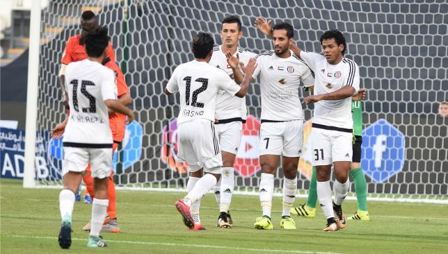 Jazira players congratulate Mabkhout on his opener