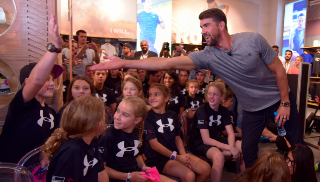 Michael Phelps with the kids at the Under Armour store opening in Dubai Mall.